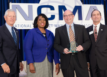 Receiving a Macfarland Writing Competition Award from the National Contracts Management Association
